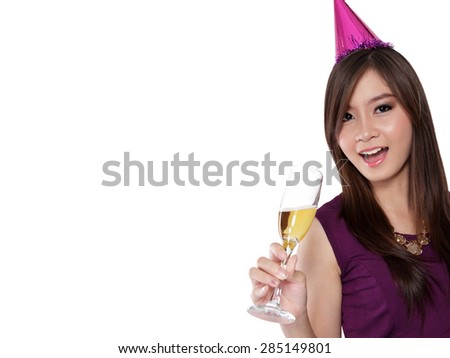 Young Asian girl in party style looking at camera with cheerful smile while holding champagne glass, isolated on white background with copyspace - stock photo