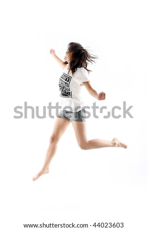 young asian girl jumping up in the air - stock photo