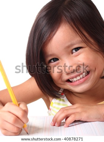 young asian girl learning to write