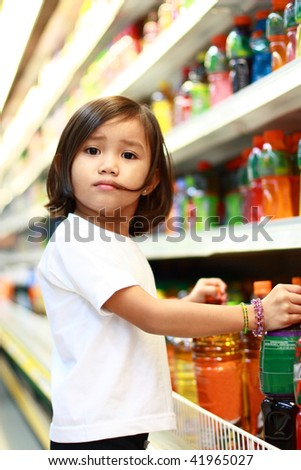 young asian girl shopping at the grocery