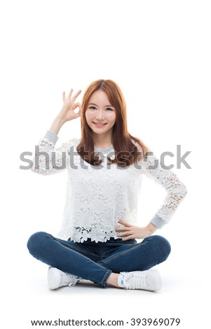 Young asian girl sitting on the floor isolated on white background. - stock photo
