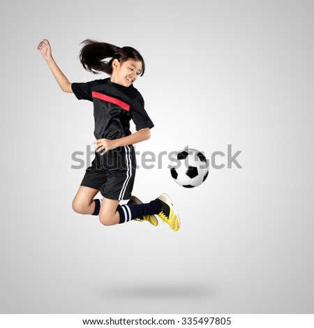 Young asian girl soccer player, Isolated on grey background