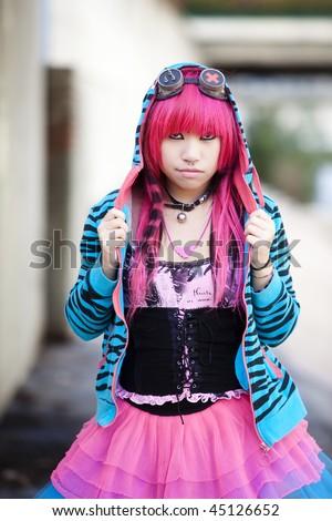 Young asian girl staring at camera. - stock photo