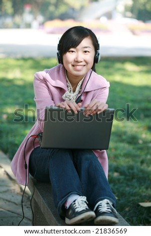 young asian girl study on laptop in college