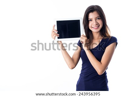 young asian girl using tablet - stock photo