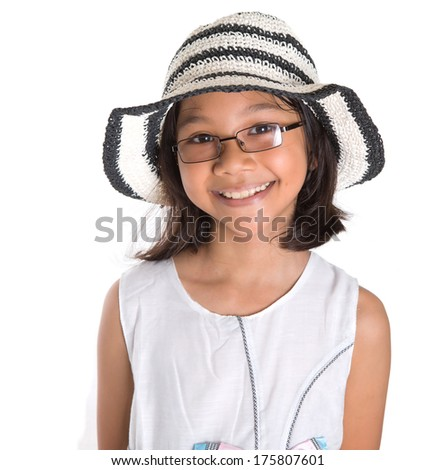 Young asian girl with a summer hat and dress over white background