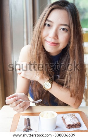 Young Asian Girl with Dessert,brownie with icecream. Close up. Indoor shot - stock photo