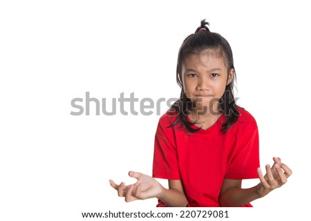 Young Asian girl with face expression over white background - stock photo
