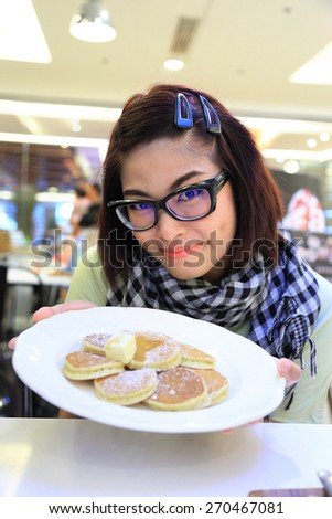 Young Asian Girl with Pancake - stock photo