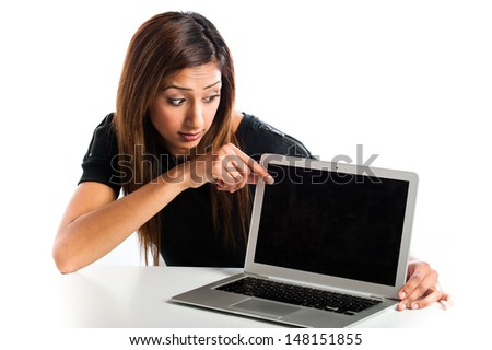 Young Asian Indian teenage woman, with a non-branded generic laptop pointing at screen that has advertising space