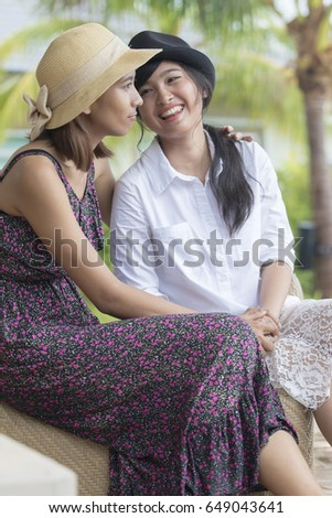 young asian lesbian woman and lovely friend smiling talking
