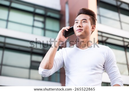 Young Asian man business life style - stock photo