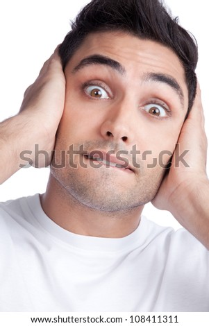 Young Asian man covering his ears isolated on white background. - stock photo