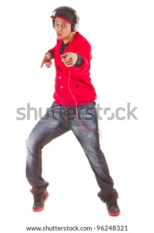 Young asian man dancing with stylish clothes. Isolated over white. - stock photo