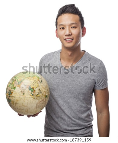 young asian man holding a world globe - stock photo
