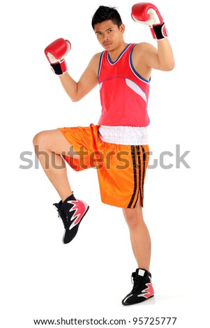 young asian man in boxing step ready to fight - stock photo