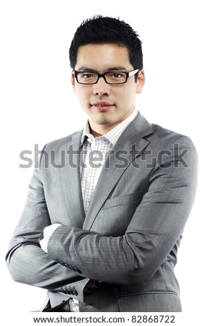 Young asian man in business attire with crossed arms - stock photo