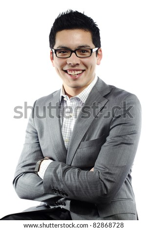 Young asian man in business attire with crossed arms laughing - stock photo