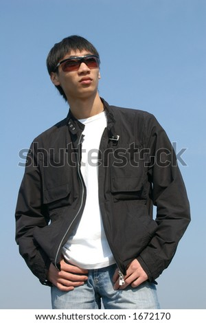 Young Asian man in sunglasses - stock photo