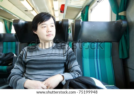 young asian man in the train - stock photo