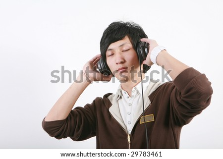 young asian man listening to the music