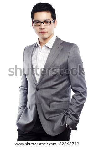 Young asian man looking confident in business attire - stock photo