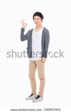 Young asian man showing okay sign isolated on white background. - stock photo