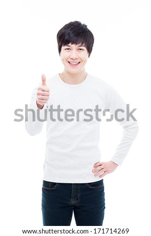 Young Asian man showing thumb isolated on white background.  - stock photo