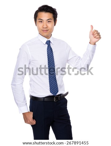 Young Asian man showing thumb up - stock photo