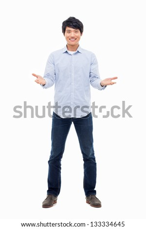 Young Asian man showing welcome sign isolated on white background.