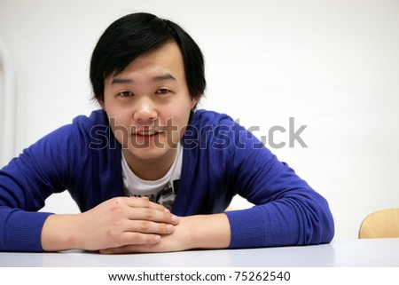 young asian man smiling - stock photo