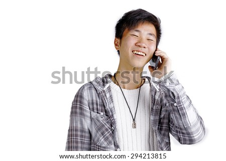 Young Asian man talking on the phone on white background - stock photo