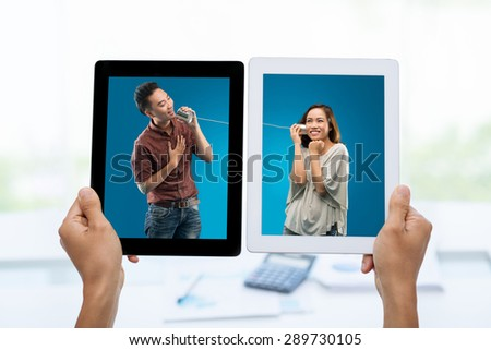 Young Asian man using a tin phone to sing a song for his girlfriend �¢?? photos on digital tablets: internet connection concept