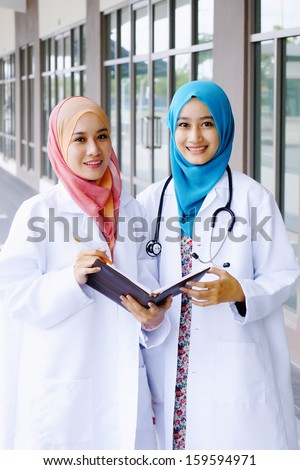 Young asian medical student woman in head scarf smile