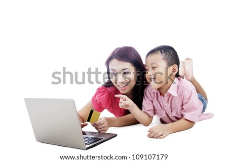 Young asian mother and her son shopping online, isolated on white