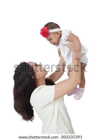Young Asian mother hold her baby daughter up high, isolated on white background - stock photo