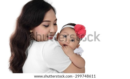 Young Asian mother with her adorable baby daughter, isolated on white background - stock photo