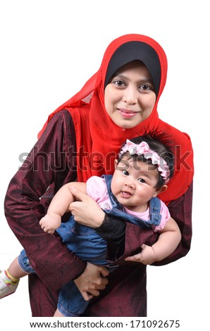 Young Asian muslim mother happy and smiling with her cute baby girl isolated on white background - stock photo