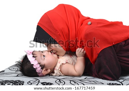 Young Asian muslim mother kissing her cute baby girl isolated on white background - stock photo