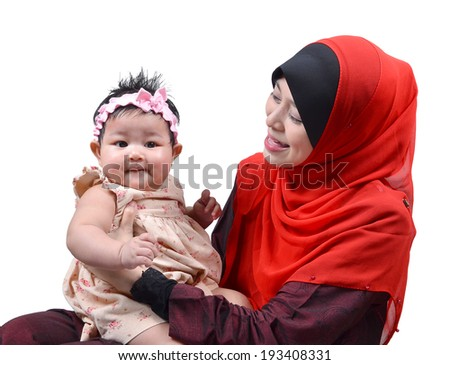 Young Asian muslim mother playing and smiling with her cute baby girl isolated on white background - stock photo