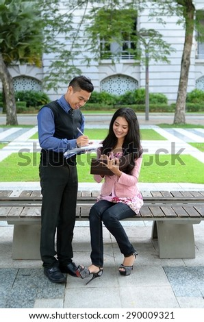 Young asian muslim woman and friend smile and happy meeting together