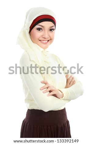 young asian muslim woman in head scarf isolated over white background - stock photo