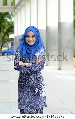 Young asian muslim woman in head scarf smile with confident pose - stock photo