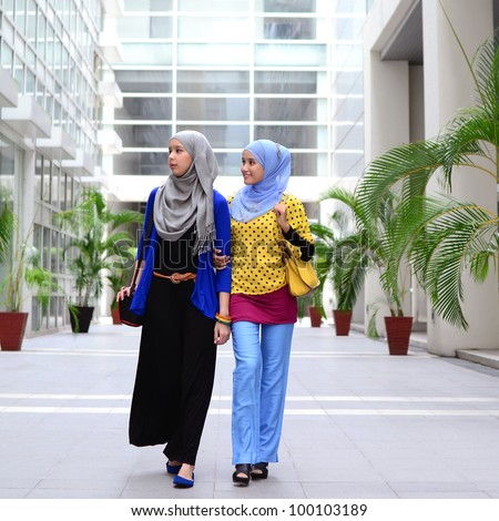 young asian Muslim woman in head scarf walk together - stock photo