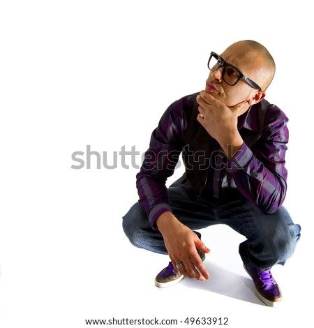 Young asian nerd styled model looking funny over white background. - stock photo