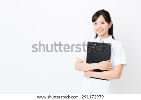 young asian nurse in the hospital isolated on white background - stock photo