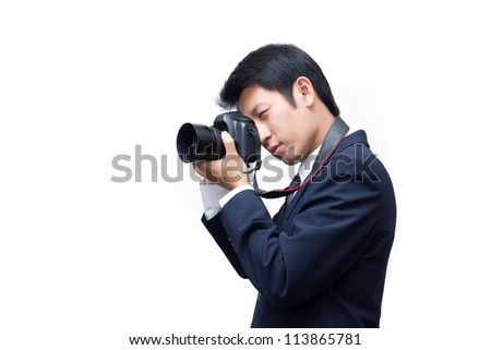 Young asian photographer taking pictures with digital camera - stock photo