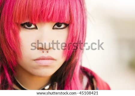Young asian pink haired girl portrait - stock photo