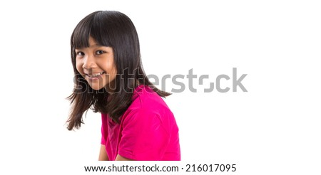 Young Asian preteen girl in pink t-shirt over white background