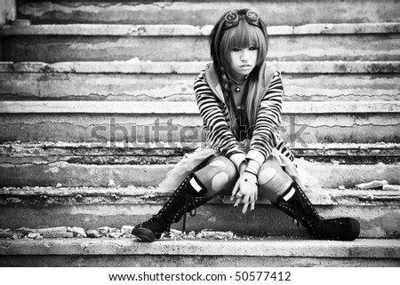 Young asian sad girl with cosplay looking. - stock photo